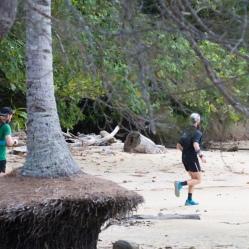 Running along the beach of Gaya Island